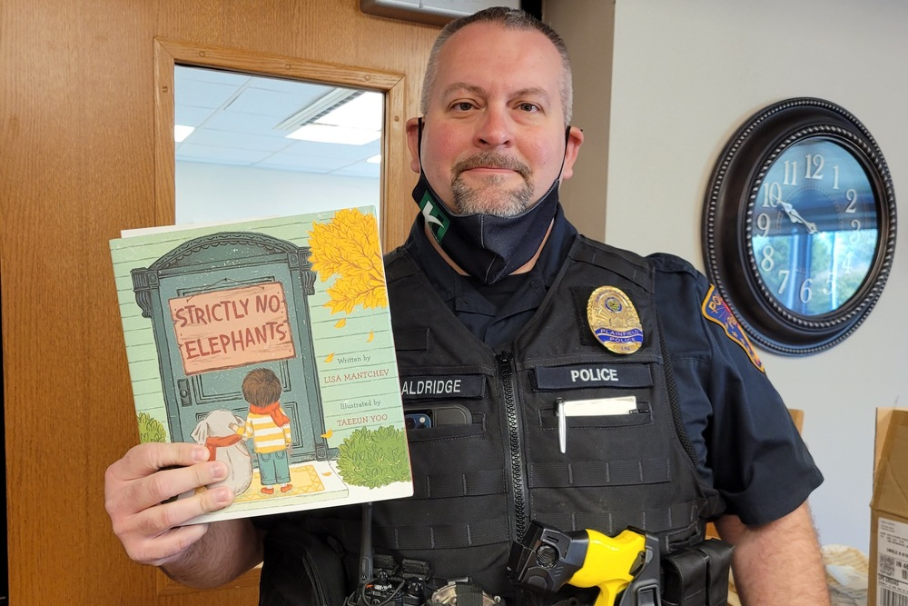 Local group donates books to elementary classrooms