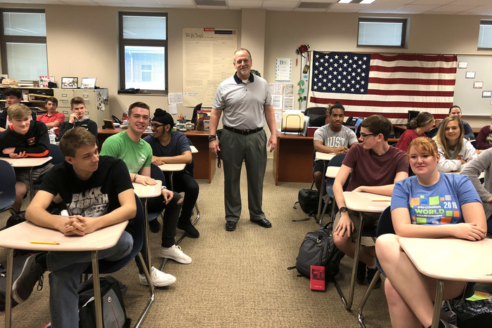Mr. Chris Cavanaugh, pictured here with students from his CHAP class.