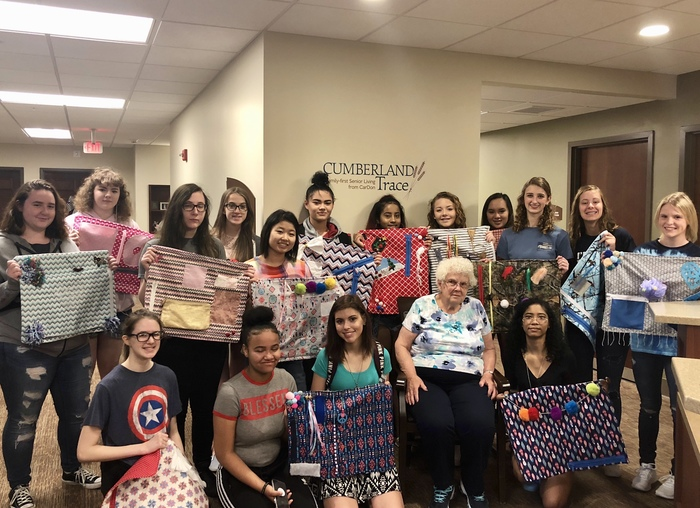 PHS students presenting fidget blankets to the residents of Cumberland Trace's Memory Care unit.