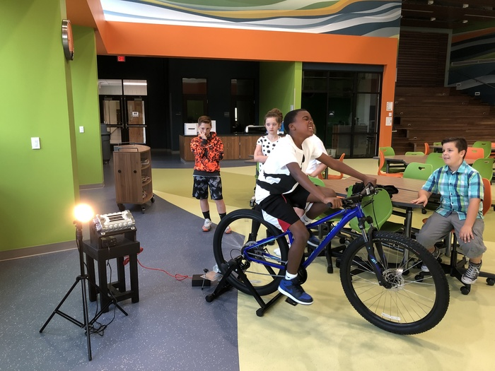 5th grade students trying out the Pedal-A-Watt
