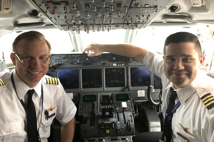 Meet PHS Grads and Delta pilots Eric Schafhauser, '89 and Scott McGurd, '03, who recently met in the cockpit!