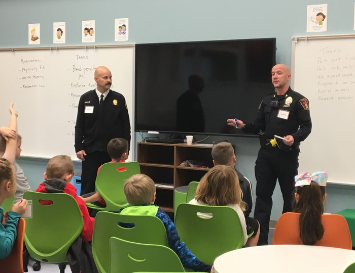 Town fire and police personnel teach about what they do at work.