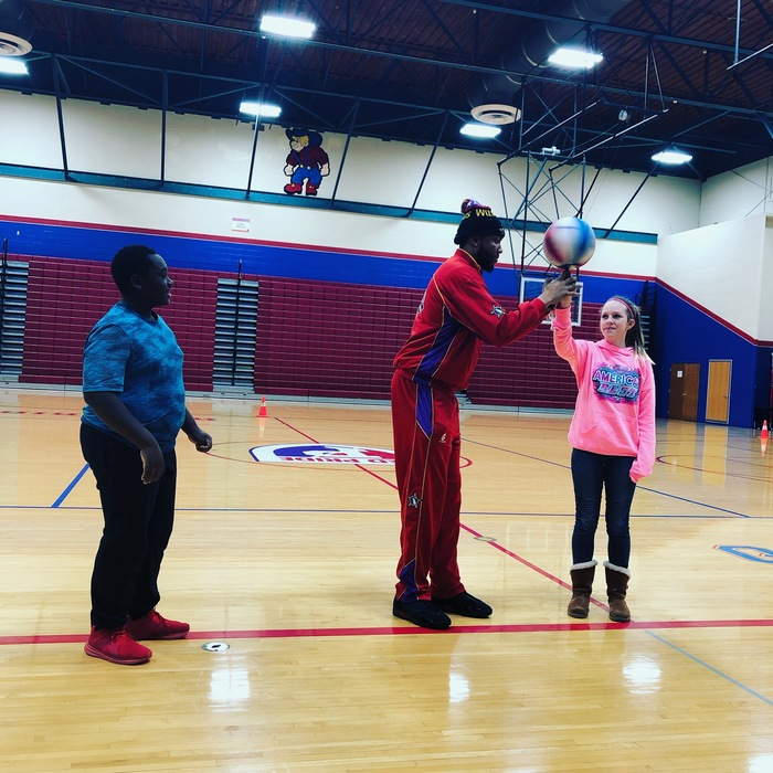 Sure, I can spin a basketball on one finger! Harlem Wizards star, Skywalker helps a PCMS 7th grade student perfect the move.