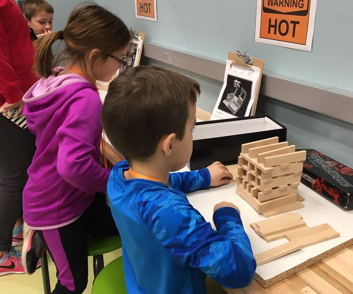Students use blocks to learn about good foundations for architectural structures.