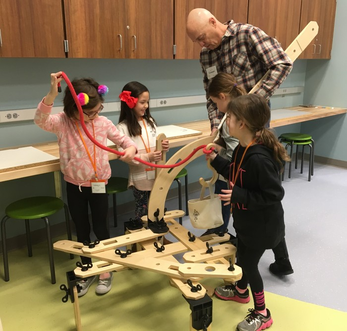 Students use the 4 C's to build a contraption that can lift something.