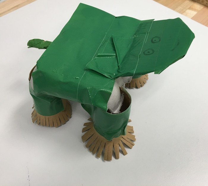 Students use cardboard attachments to create this turtle.