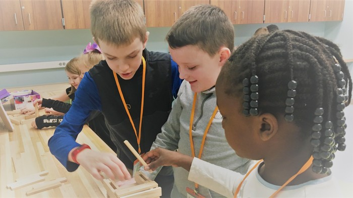 Students try a new way to build a structure.