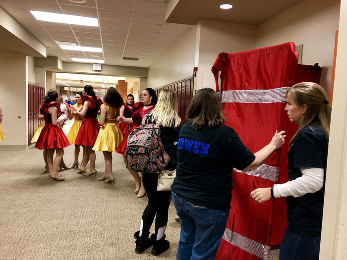 The hallway is buzzing with Femmes Fatales as they get ready for this evening's performance.