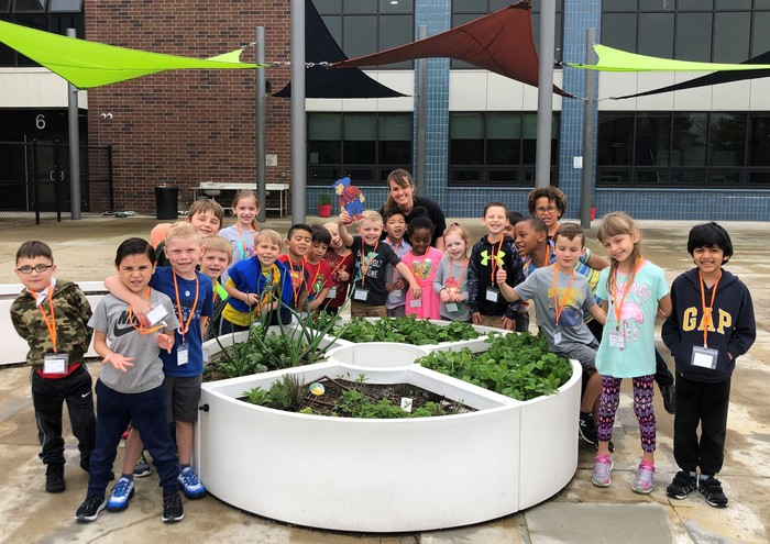 Students enjoy identifying fruits and vegetables in the Learning Garden.