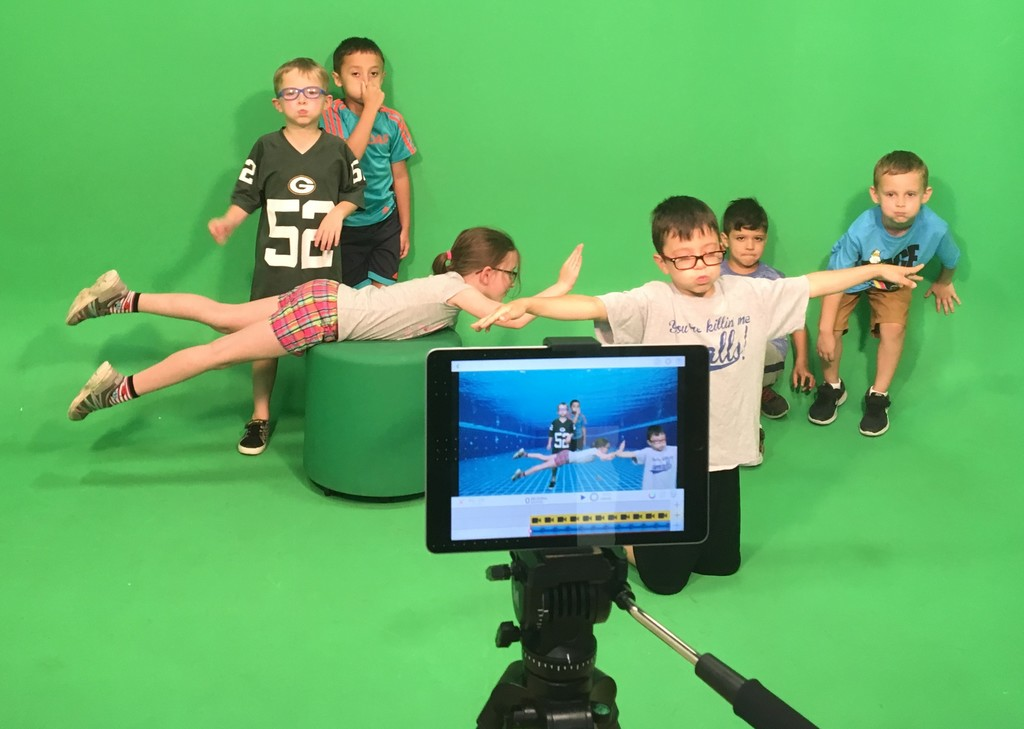 "Students ""swim"" in the green screen room at The Lab."