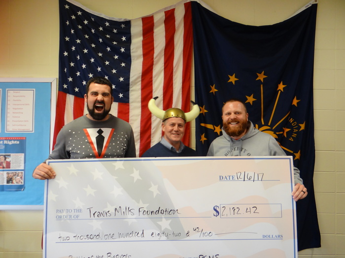 Mr. Ellis, Mr. Cooney and Mr. Johnson pose with their donation to the Travis Mills Foundation.
