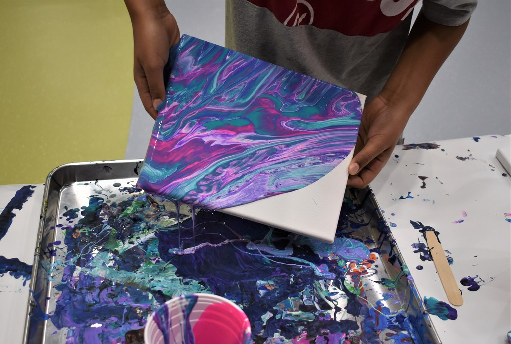 paint pouring off a canvas, bright colors