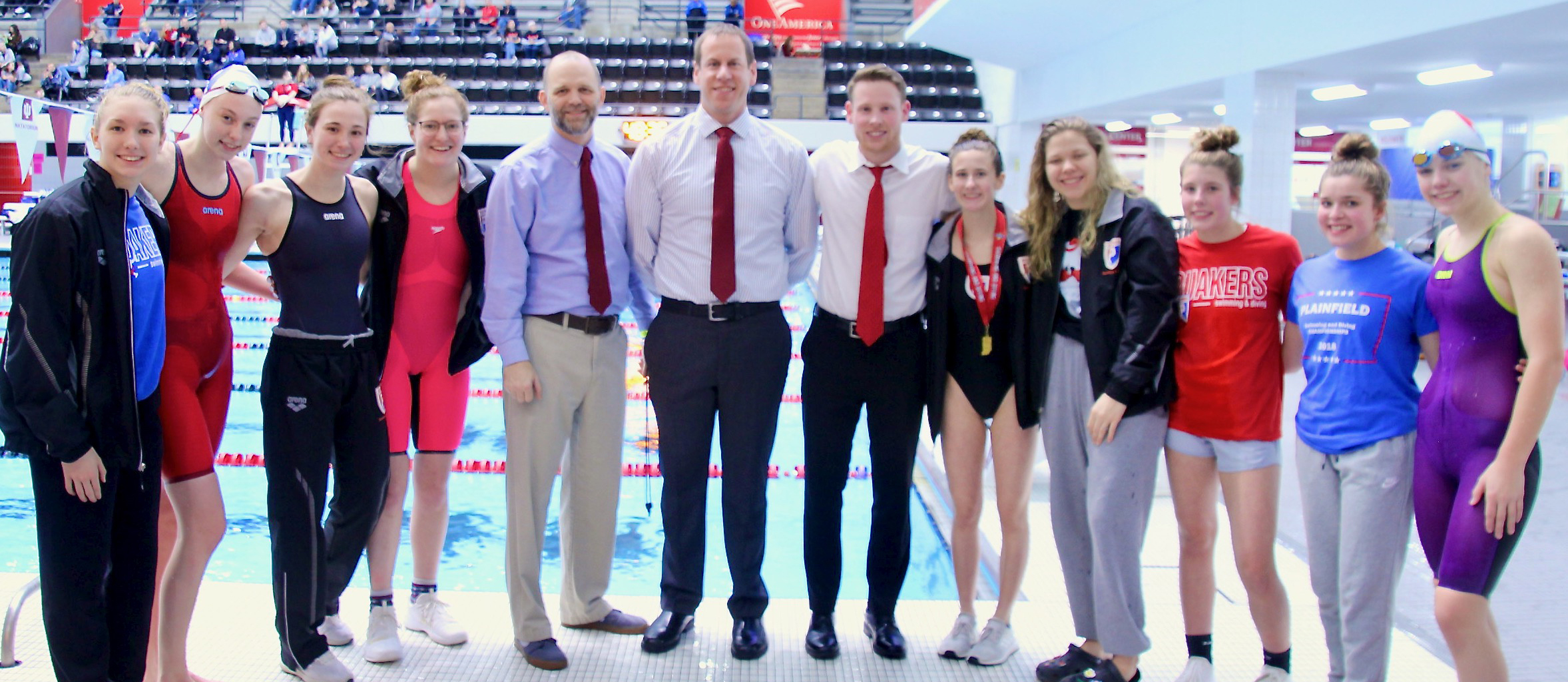 Student-athletes and coaches at the IHSAA Girls State Swim & Dive Meet