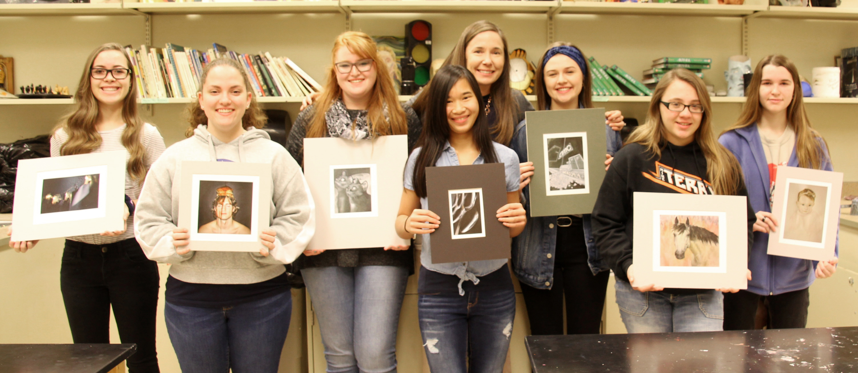 PHS art students featured here with Mrs. Armstrong, after winning prestigious awards for their artwork. Congratulations!