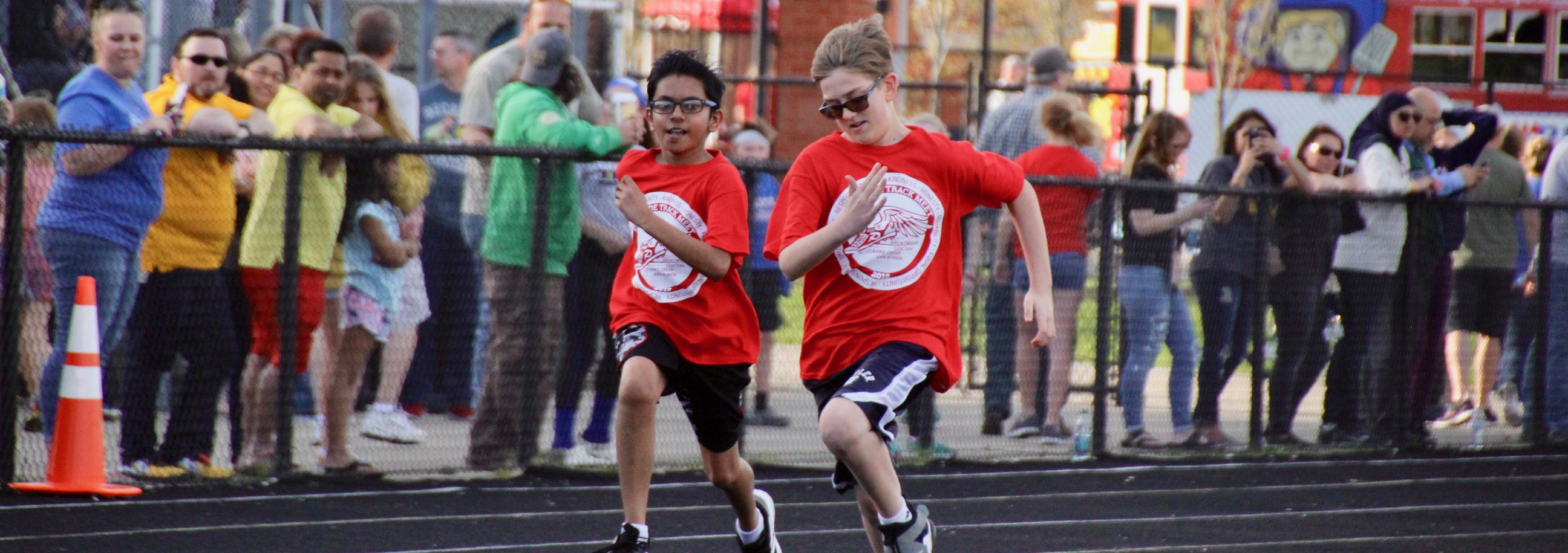 The 5th grade track meet, held at the high school track and field, brings together students from all four elementary schools for a fun evening of friendly competition.
