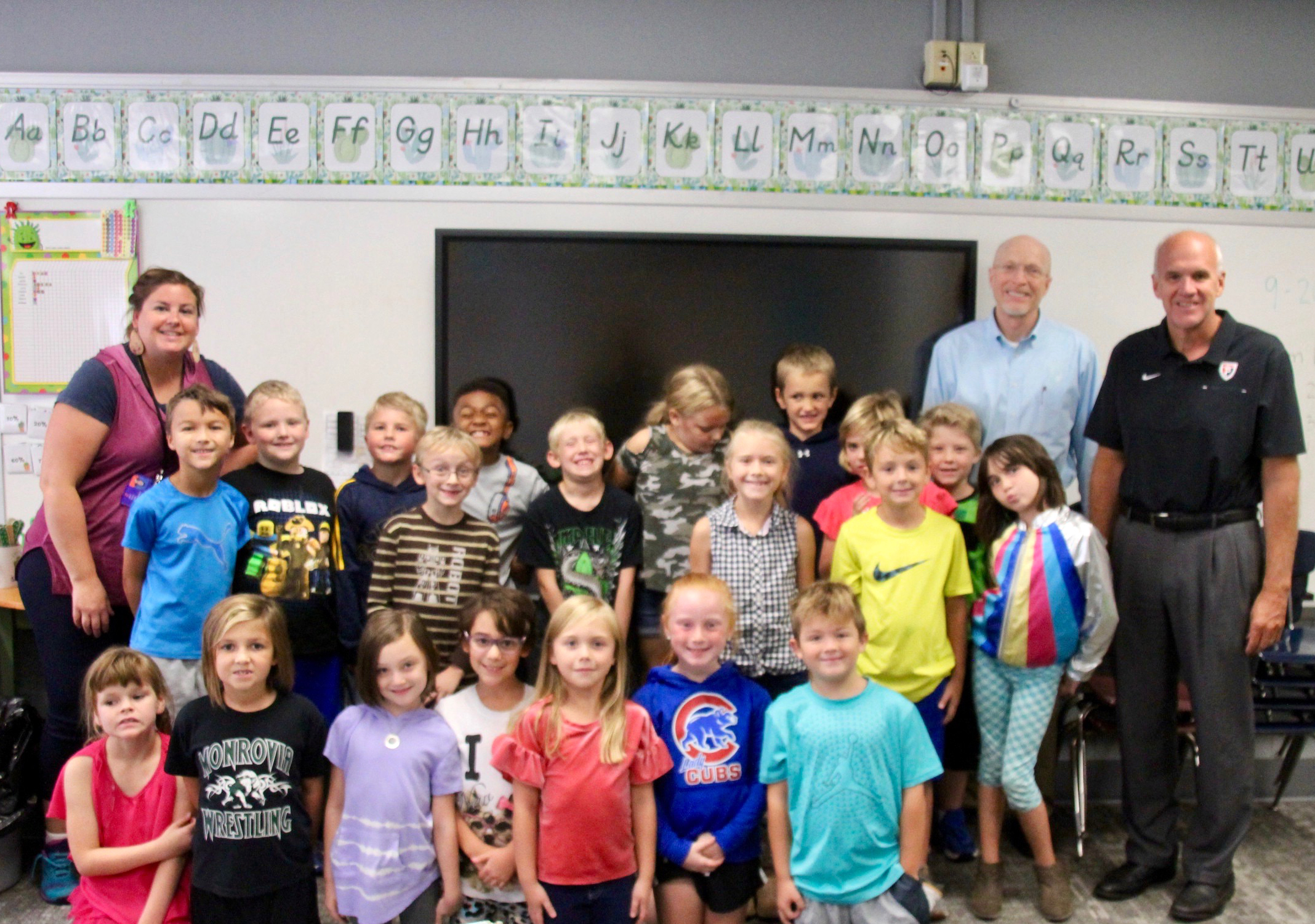 Mr. Olinger and Mr. Helmuth pose with Mrs. Craney's class after telling them about the 2019 National Blue Ribbon School of Excellence Award