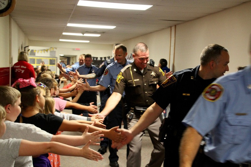 Local police, who serve in many capacities, brought smiles to student's faces as they eagerly gave high fives.