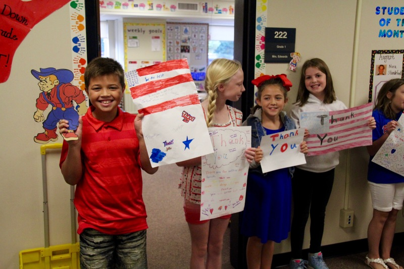 Mrs. Gray's 3rd grade class was eager to wave the flags they'd made for Patriot Day, and yes, #QuakerFaces were a big part of the occasion!