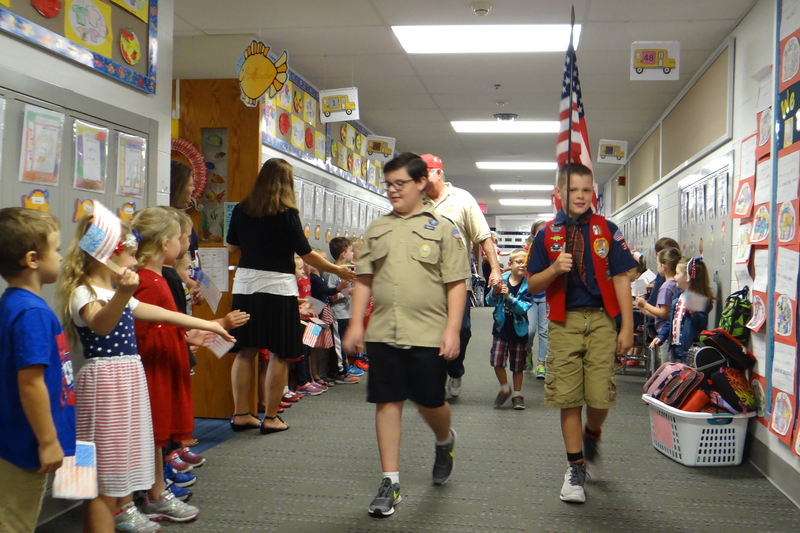 At @cnquakers, Boy Scouts carried the flag and led the way for the honored guests