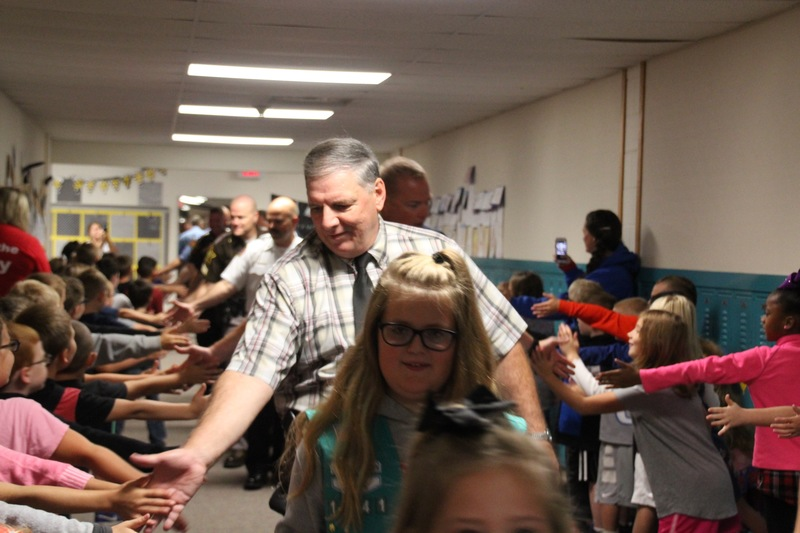 Plainfield Police Chief, Mr. Krieger, was all smiles as he high five-d the students at Van Buren