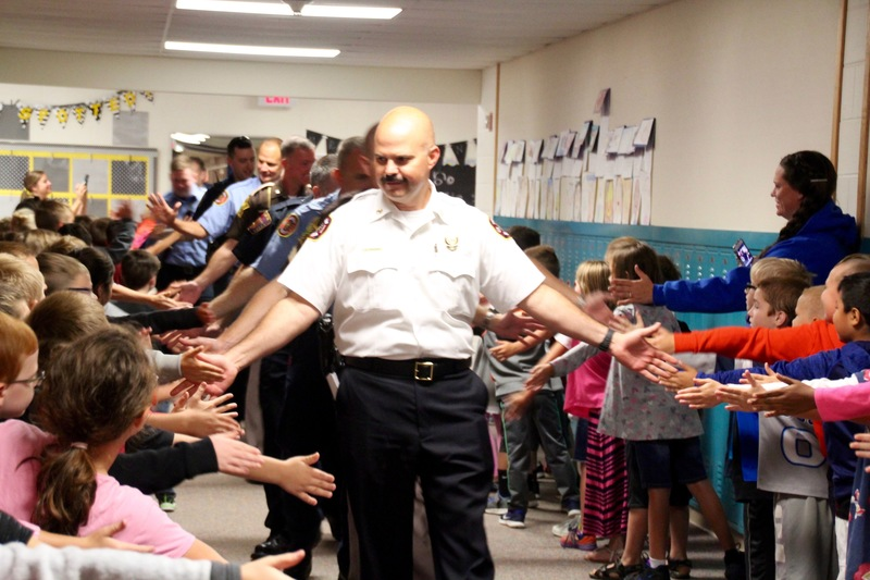 Plainfield Fire Territory Chief, Mr. Thacker, greeting students as he and his colleagues were honored on Patriot Day