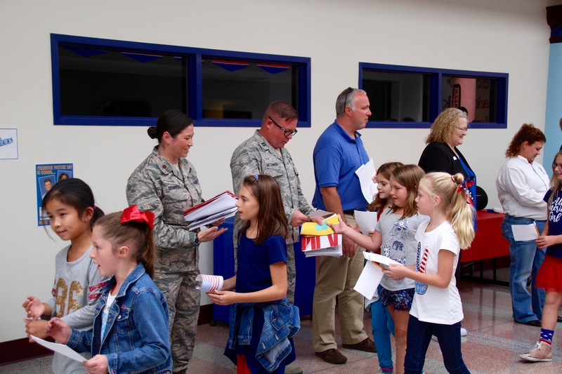Clarks Creek students present members of the military with cards and letters on Patriot Day