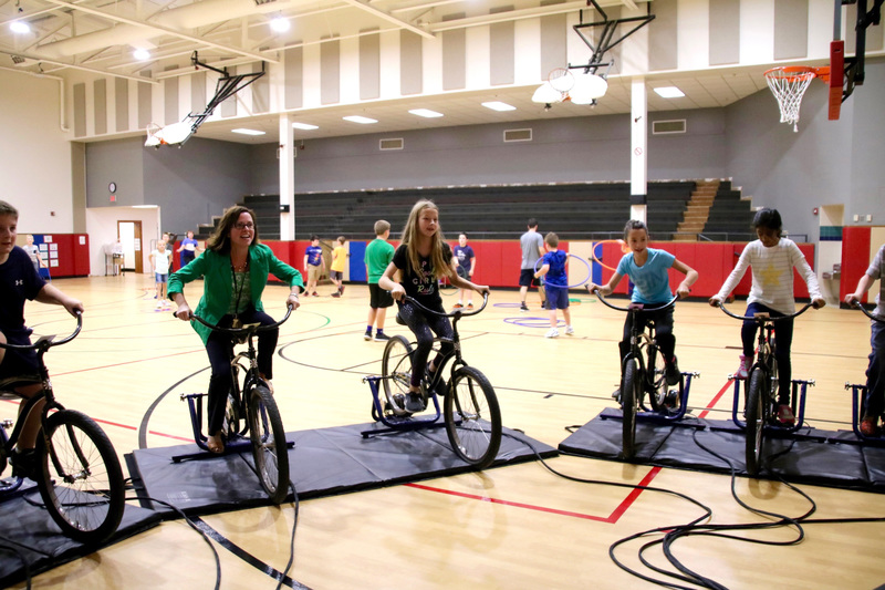 Mrs. Thacker hopped on a bike and discovered that racing uphill against fifth grade students can be quite the challenge!