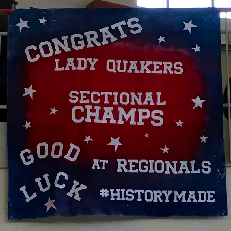 Congratulatory banner hangs in the high school ellipse