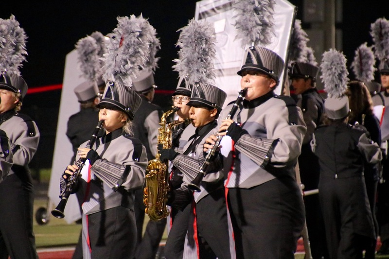 Pictured here, the clarinet and saxophones strike a pose during the band's competition show.
