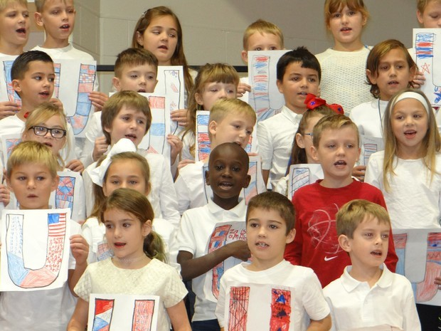 Holding their patriotic artwork and beaming from ear to ear, these students sang their hearts out for their guests.