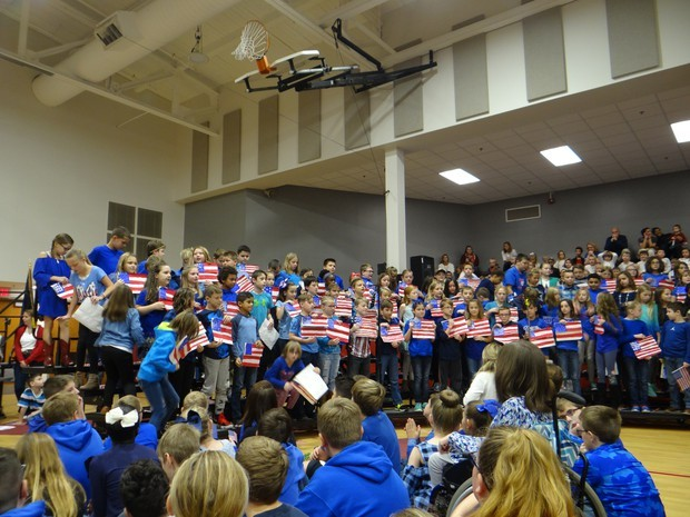 Central students use their hand-colored flags to illustrate their performance.