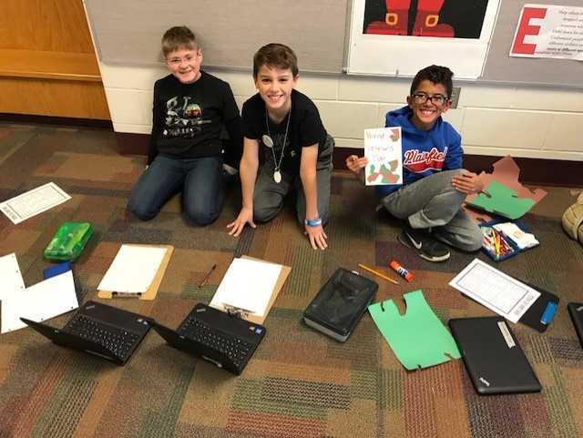 These 4th grade boys did some research before illustrating their Veterans Day cards.