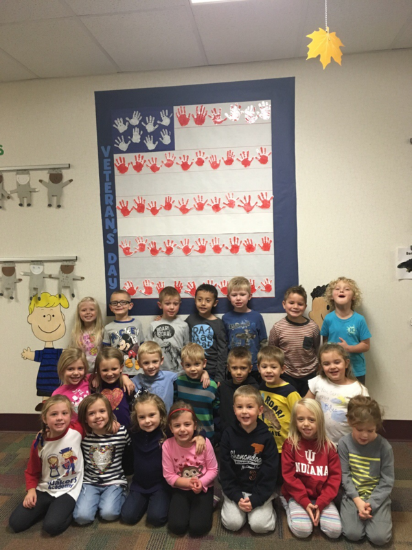 "Using their handprints to create their own flag, these pre-schoolers say ""thank you, Veterans!"""