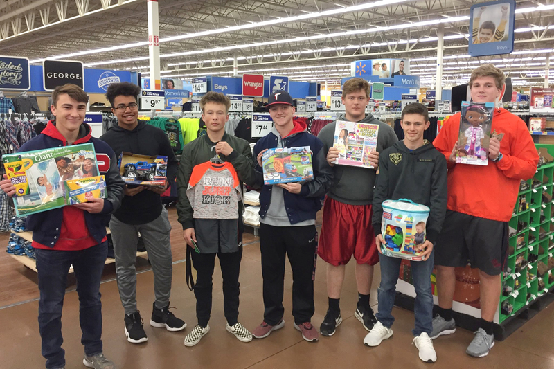 PHS football players provided Christmas for a family this year, and the boys pictured here enjoyed shopping for toys.