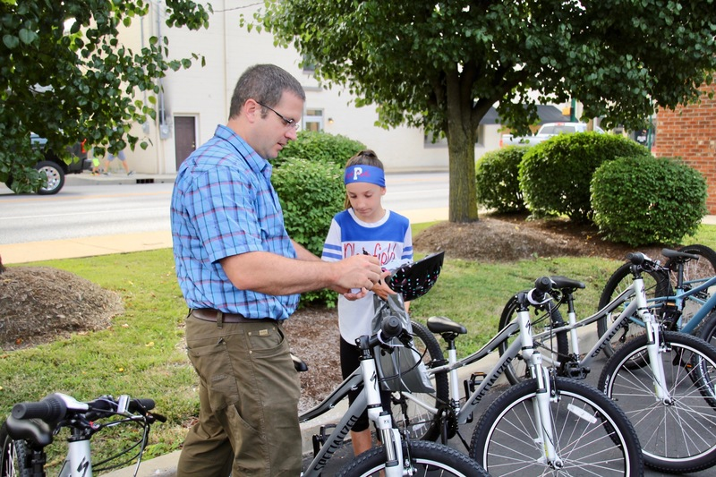 Daniel Gibbs, reviewing safety information with one of the Central students