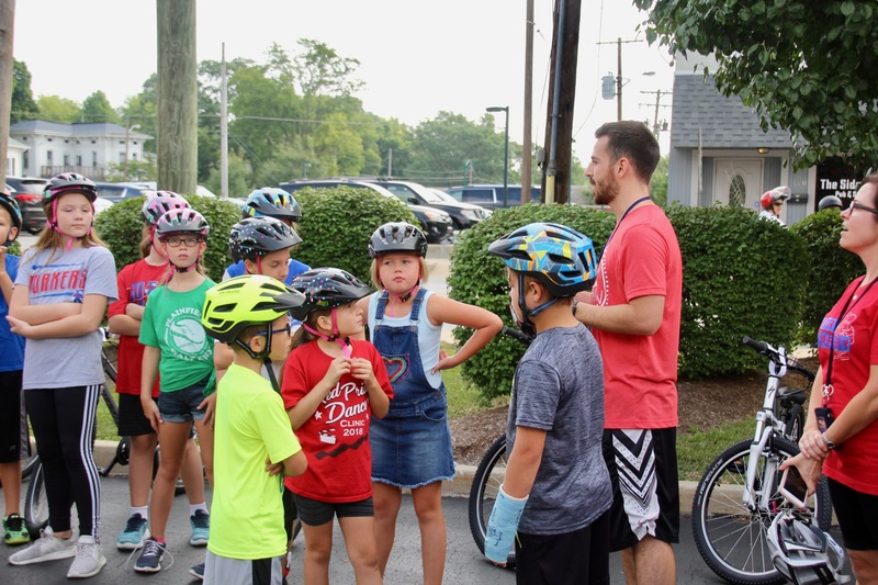 Mr. Wheeler explaining the gift of bicycles to his students