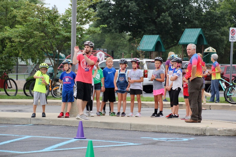 Mr. Wheeler explaining the bicycle obstacle course to the students