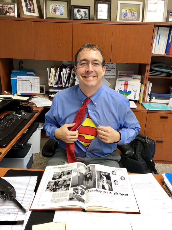 PHS Assistant Principal Brent Schwanekamp shows off his Clark Kent attire during Favorite TV/Book Character day