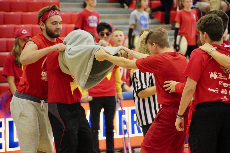 One of the Pep Session games required several male students to exchange a t-shirt with their arms connected