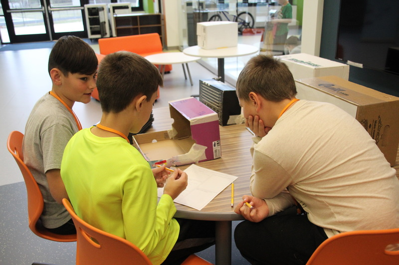 Working in Collaboration Court, students share ideas to create their own stop-motion animation.